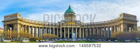SAINT PETERSBURG RUSSIA - APRIL 25 2015: Panorama of the Kazan Cathedral with green park and fountain between the wings of massive colonnade on April 25 in Saint Petersburg.