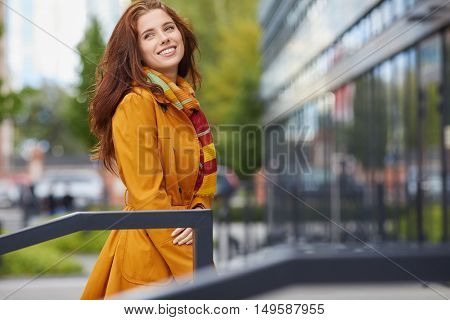 beautiful young woman in autumn city