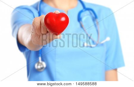 Doctor cardiologist with red heart and stethoscope on white background