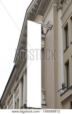 Blank banner flag on the wall of building. Mock up