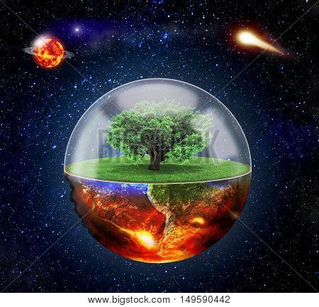 Concept of destruction. Half of the planet is covered by the apocalypse the other half is transparent. Transparent half covered with grass on which the tree is protected by a protective barrier. The planet on space background with a comet in the backgroun