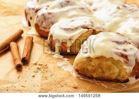 Cinnamon buns glazed with cream cheese  .