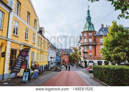 September, 23th, 2015 - pedestrian street in Hillerod, Denmark. Old scandinavian houses, restaurants and narrow street of cobblestones near Frederiksborg castle.
