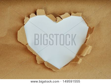 Photo which shows a white heart on paper background