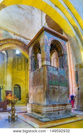MTSKHETA GEORGIA - JUNE 6 2016: The St Sidonia's grave in prayer hall of Svetitskhoveli Cathedral decorated with monument covered by old frescoes and famous as the Holy Life-giving Pillar on June 6 in Mtskheta.