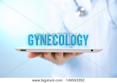 Gynecology concept. Professional doctor with tablet on blue background