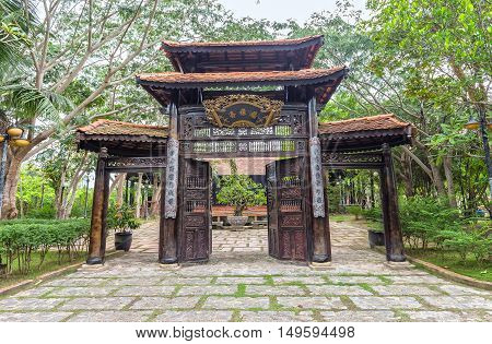 Long An, Vietnam - September 18th, 2016: Entrance Ancient Pagoda imperial architecture beautiful carved wood attracts tourists to visit in Long An, Vietnam
