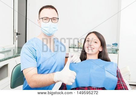 Patient And Orthodontist Showing Thumb Up Gesture