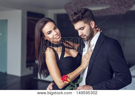 Young macho man give rose to older woman secret date