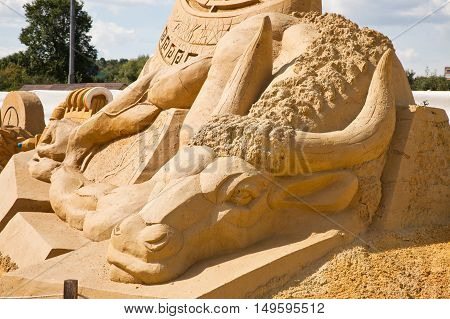MOSCOW RUSSIA - August 18.2013: Exhibition of sculptures made of sand in Kolomenskoye city park. Sculpture History about Minotaur and Theseus
