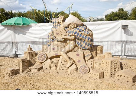 MOSCOW RUSSIA - August 18.2013: Exhibition of sculptures made of sand in Kolomenskoye city park. Sculpture Our yard