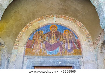MTSKHETA GEORGIA - JUNE 6 2016: The fresco of Virgin Mary with Baby Jesus over the entrance to Svetitskhoveli Cathedral on June 6 in Mtskheta.