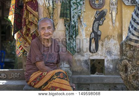 Tenganagan Bali Indonesia September 10th 2016: old lady at her doorstep