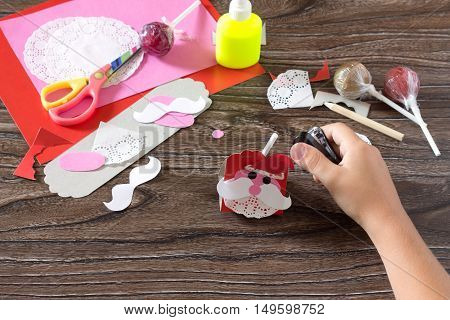 The Child Create A Greeting Packaging For Candy Santa Claus On Paper, Attach Paper To Detail. Childr