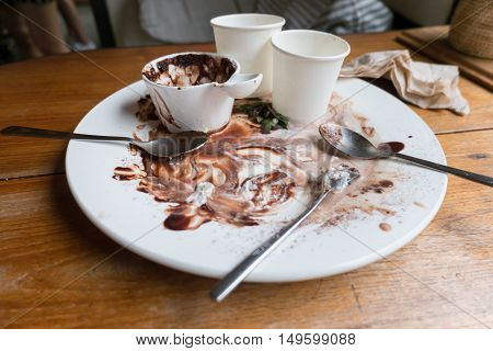 Dirty white dishes stained chocolate empty after eating