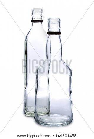 Bottle glasses and alcohol on white background