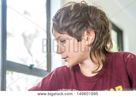 indoor portrait of young happy smiling preteen boy at home