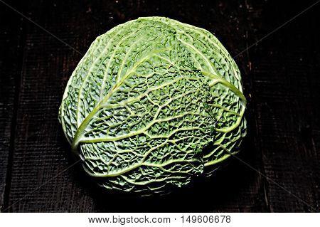 Savoy Cabbage On A Dark Background Close-up
