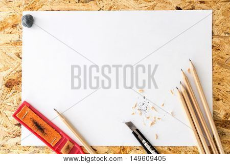 Bunch Of Pencils With Kneaded Eraser, Sandpaper Block And Cutter Knife With Shavings, On Blank White