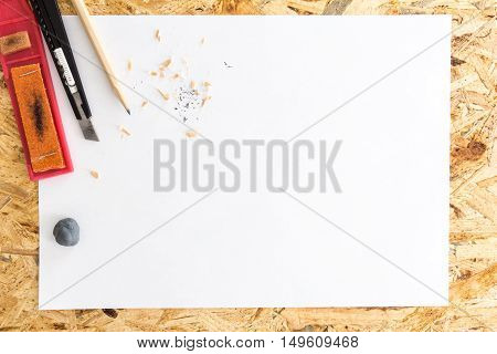 Pencil With Kneaded Eraser, Sandpaper Block And Cutter Knife With Shavings, On Blank White Sheet Of