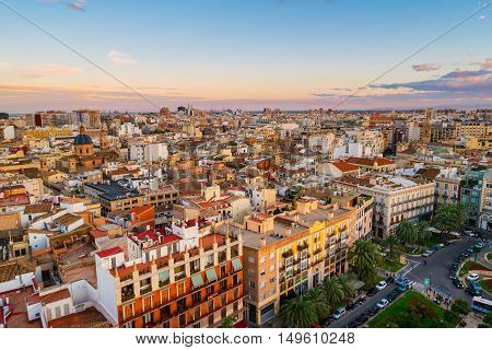 Aerial view of Valencia, Spain in the evening. Plaza de la Reina with many cafes and restaurants, very popular among tourists. Cloudy colorful sky
