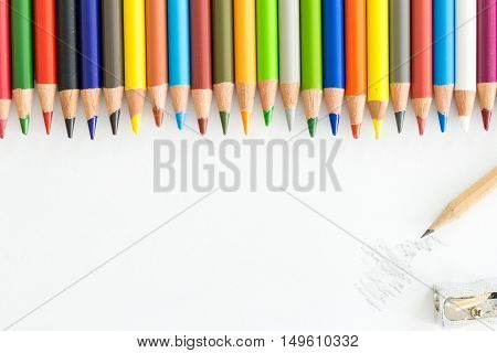 Bunch Of Colorful Pencils And One Graphite Pencil Doodling And Sharpener, On White With Copy-space.