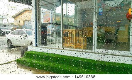 Raindrops on window background. Rainy day and raindrops background