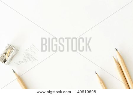 Bunch Of Pencils With Sharpener, On Blank White Sheet Of Paper