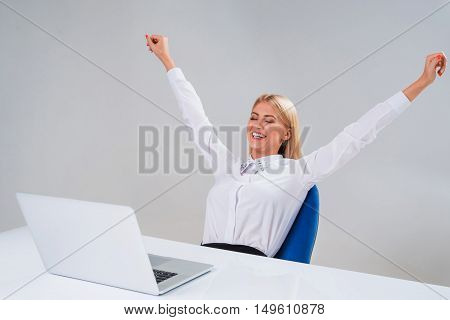 Young businesswoman working at laptop computer. surprised pleased