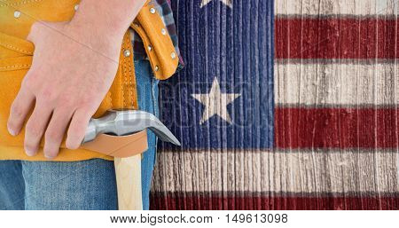 Close-up of male repairman wearing tool belt against composite image of usa national flag