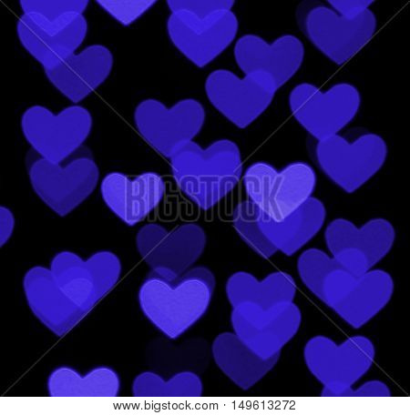heart bokeh background, photo blurry objects, blue on black