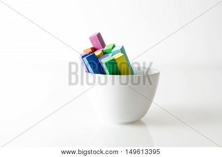Bunch Of Square Colorful Pastel Chalks In White Bowl, On White Background