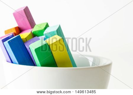 Bunch Of Square Colorful Pastel Chalks In White Bowl Closeup, On White Background