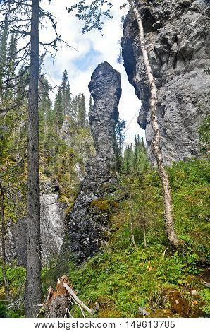 Geological monument in a rocky gorge. National Park Yugid-VA in the Northern Urals.