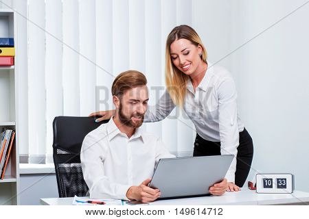 man and woman discussing a working project at the computer