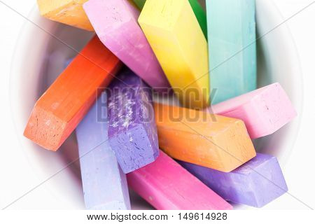 Square Colorful Pastel Chalks Tops Closeup, On White Background