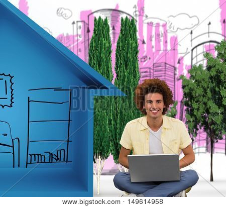 Smiling young man using laptop on floor against view of house icon