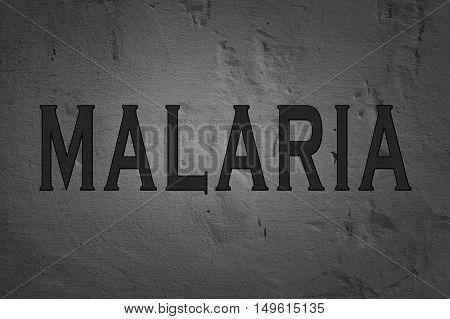 Word Malaria isolated on dark background, warning text.