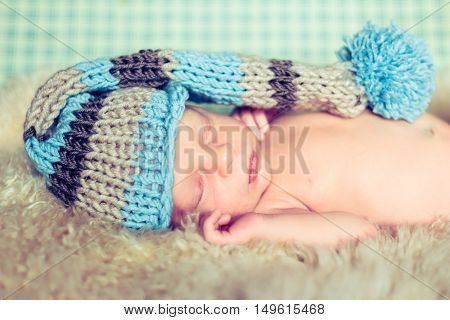 Newborn Baby In A Funny Hat.