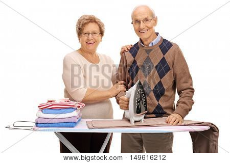 Happy mature couple ironing together isolated on white background