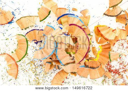 Colorful pile of pencil shavings on white background