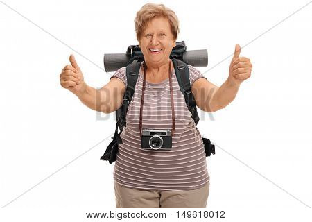 Delighted senior hiker giving two thumbs up isolated on white background