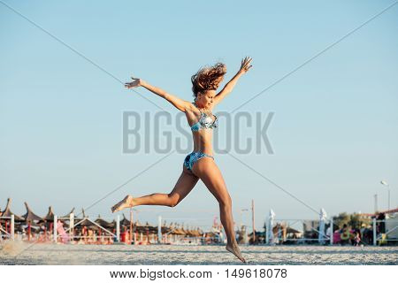 Jumping Woman On A Bech