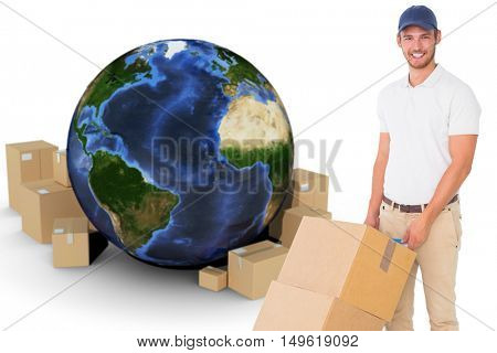 Happy delivery man pushing trolley of boxes against globe and cardboard boxes