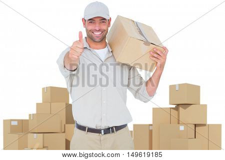 Delivery man with cardboard box gesturing thumbs up against cardboard boxes over white background