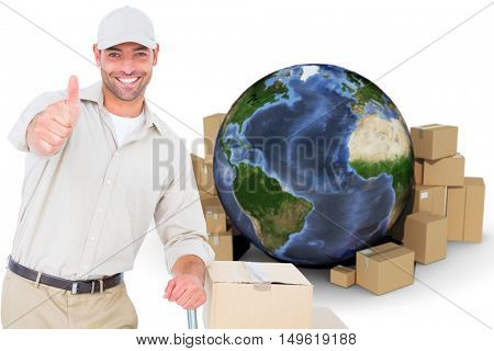 Delivery man gesturing thumbs up on white background against globe surrounded by cardboard boxes