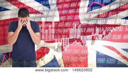 Upset man standing with his head in hands against digitally generated great britain national flag