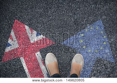 Casually dressed womans feet against close-up of european flag