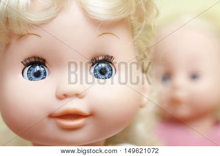 The faces of the blonde dolls. Close up.