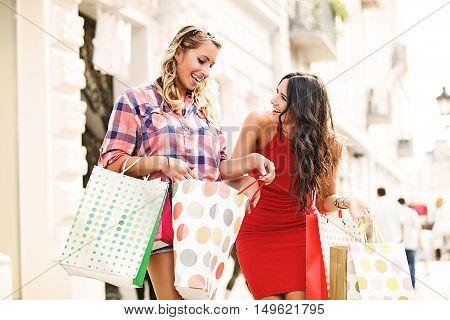 Young woman having fun in shopping. Sunny day.